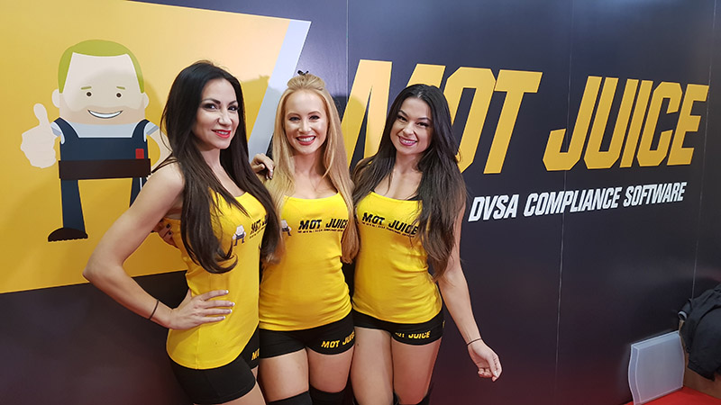 The MOT Juice Girls at Mechanex Sandown Park with the MOT Juice Stand.